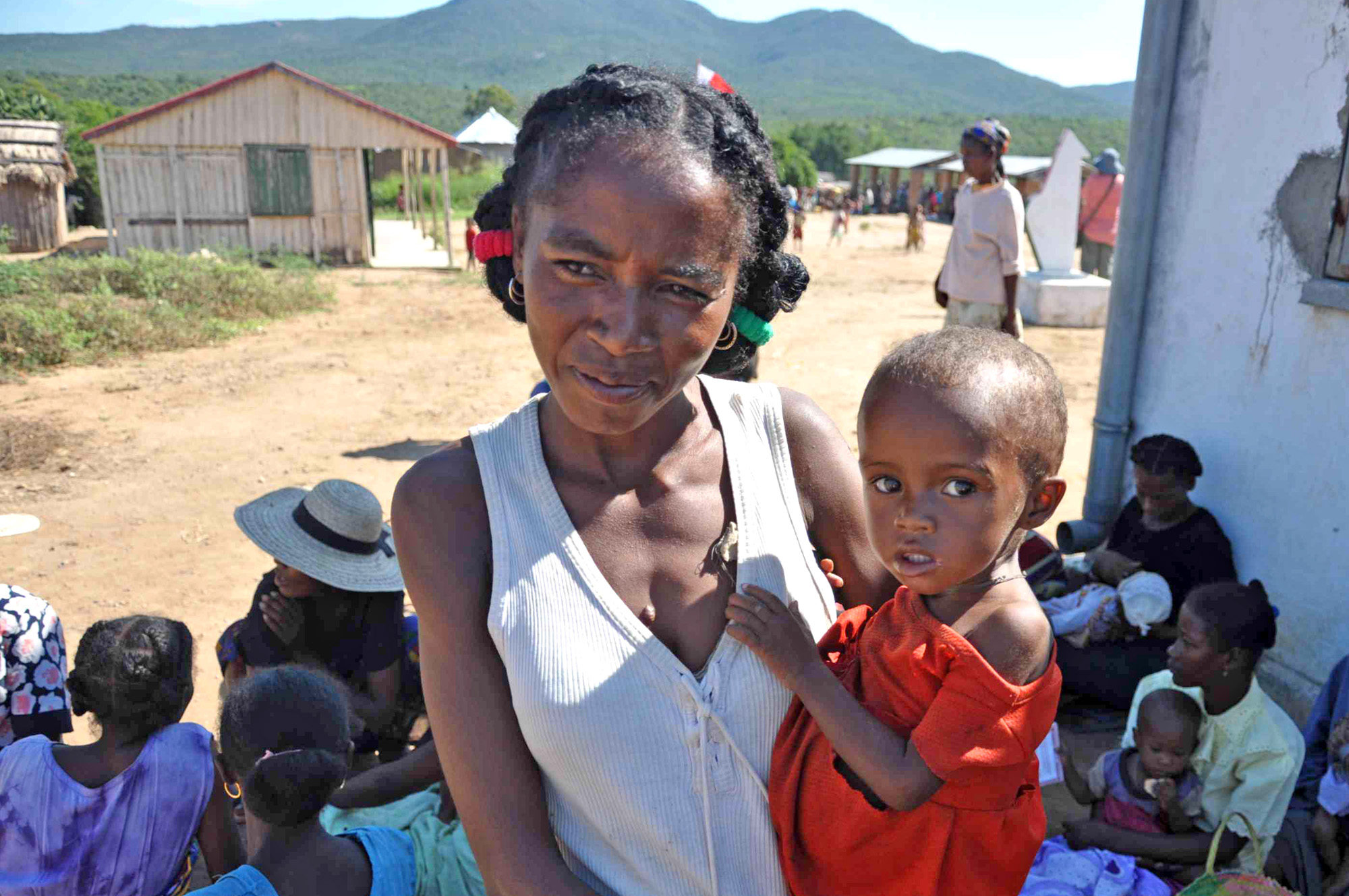 A Malagasy woman and her malnourished child wait at a clinic in