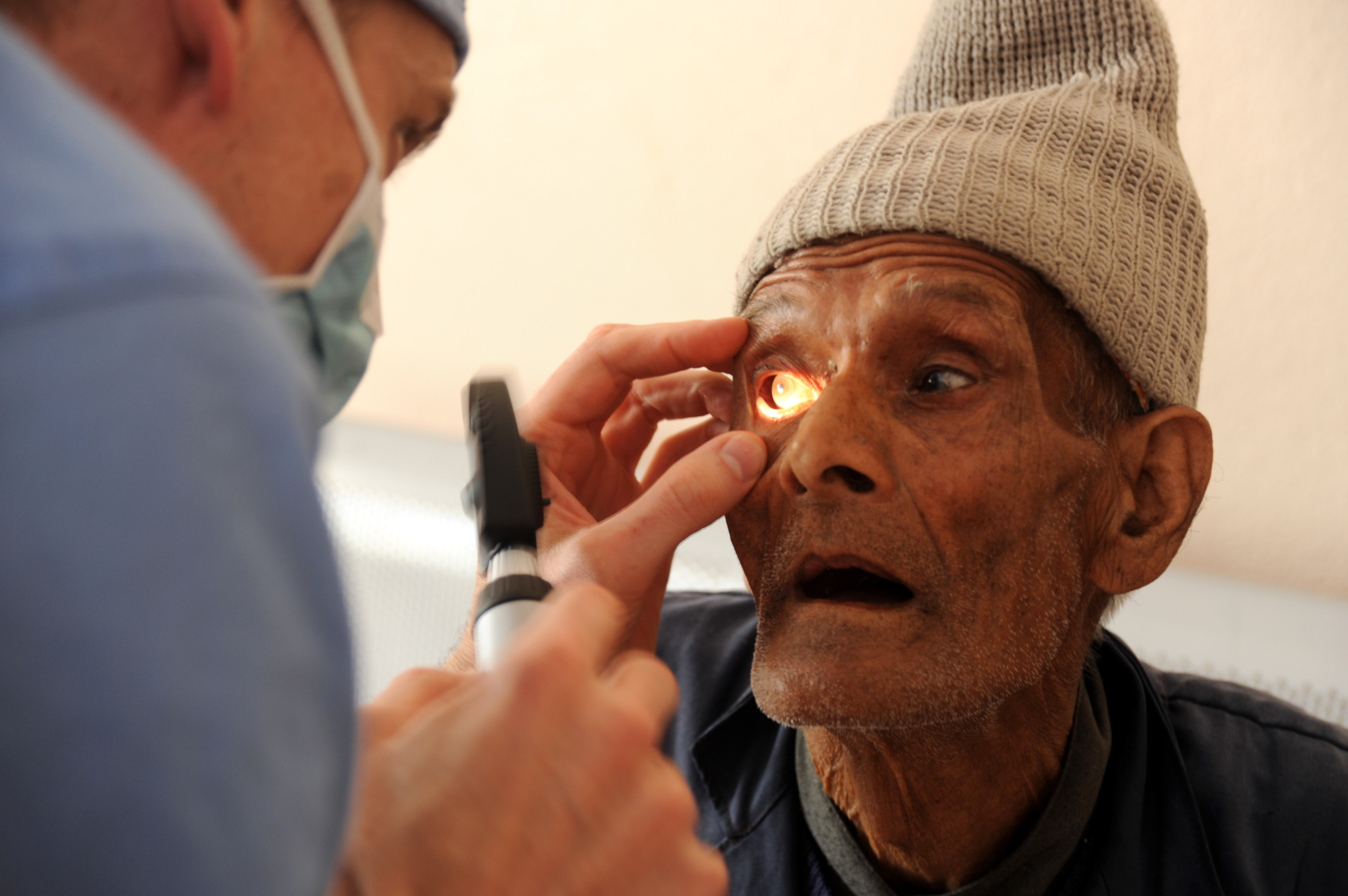 Dr. Carey Dozier does a preliminary examination of a patient at an eye camp supported by the Druk Amitaba Monastery in Sitapaila, Kathmandu