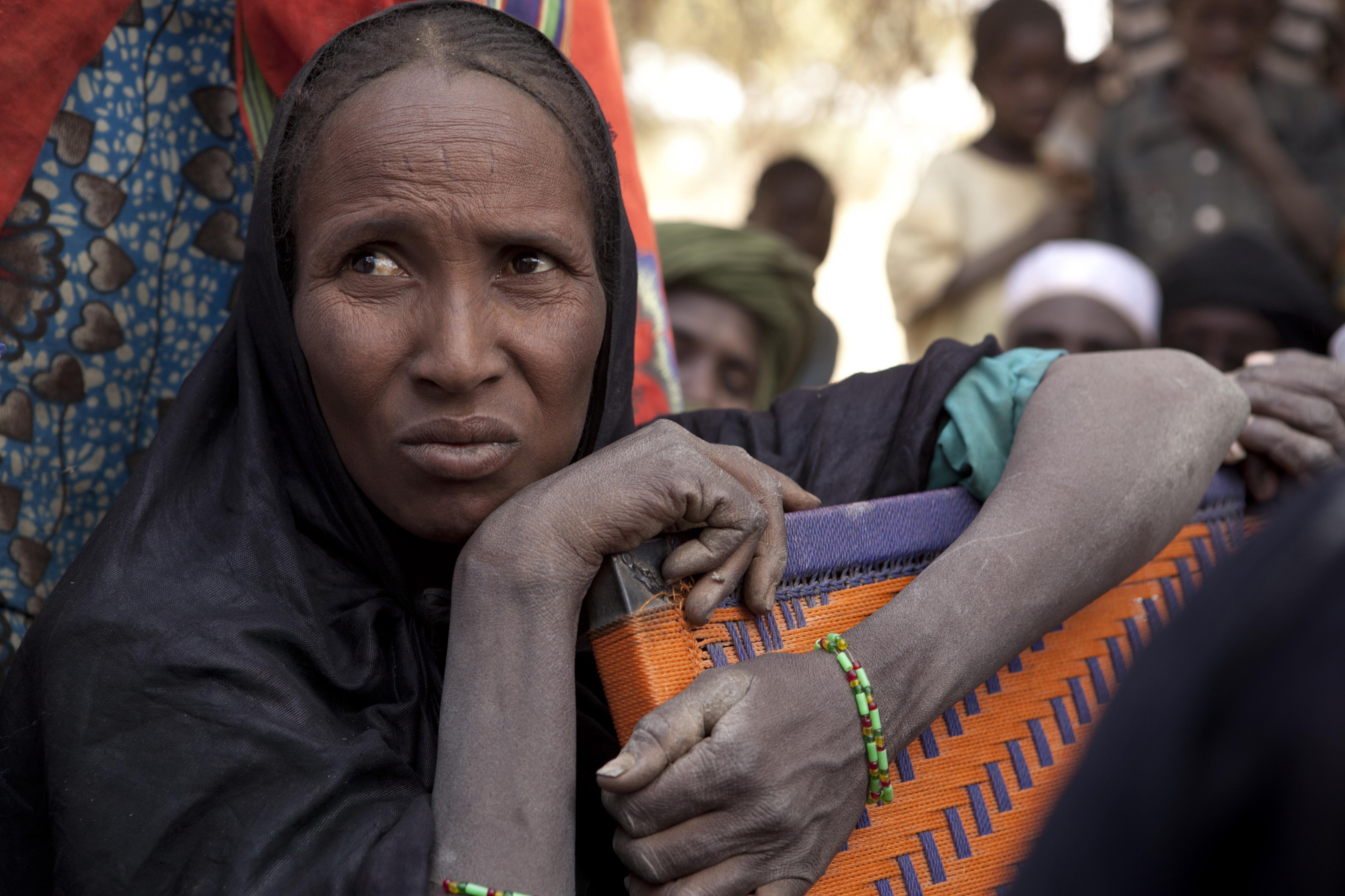A Malian refugee woman in Mangaize, northern Niger, ponders her future. In January, she and her family fled Menaka, a town in Mali, because of the general insecurity and fighting between the army and Tuareg fighters