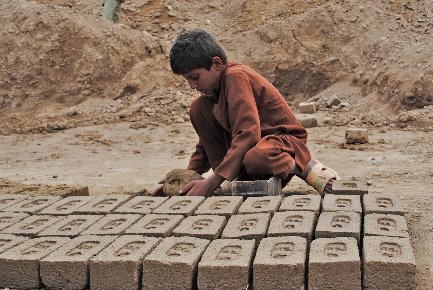 A boy makes bricks at a kiln in Afghanistan