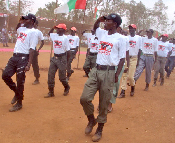 Members of Burundi's ruling party youth wing march at a rally in September 2012