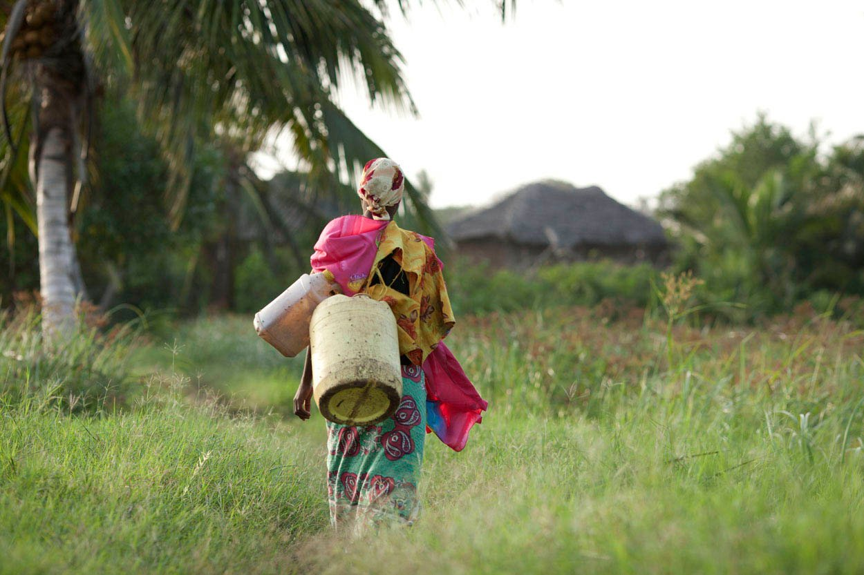 A Pokomo woman carries water back to her village in the Tana Delta, Kenya