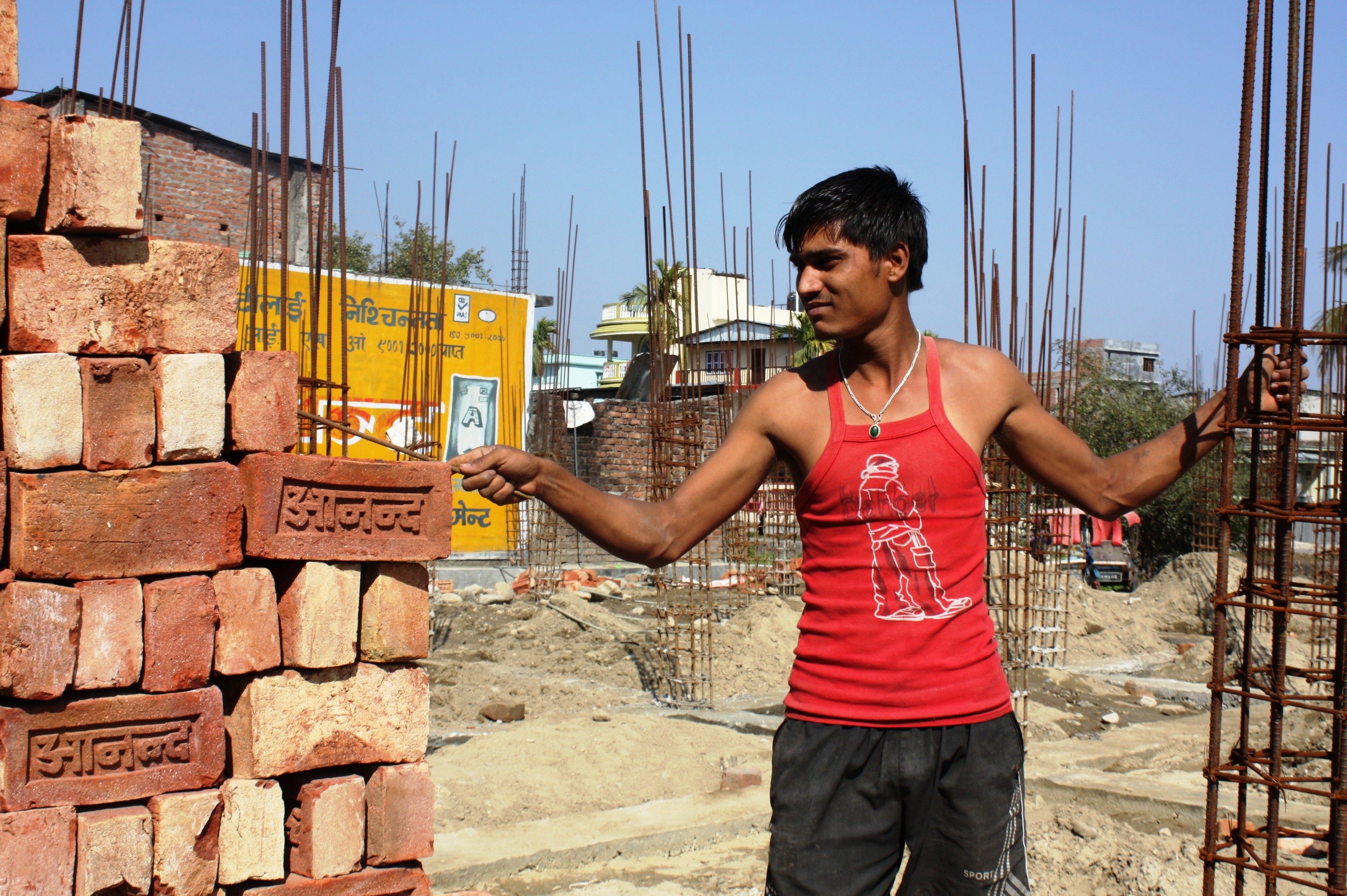 A mason working in the town of Damak, western Nepal. Training masons in how to build an earthquake-resistant home is a key challenge