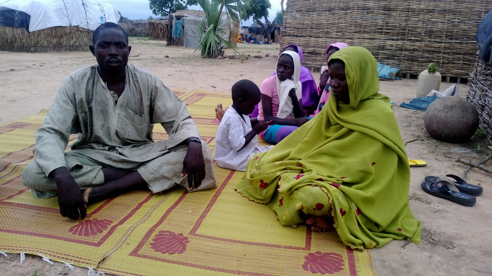 Mahamat Haroun Dahab and part of his family in the southern Chad village of Tadjou, in Tissi. Tadjou is home to hundreds of Chadians who recently returned home after fleeing conflict in neighbouring Darfur