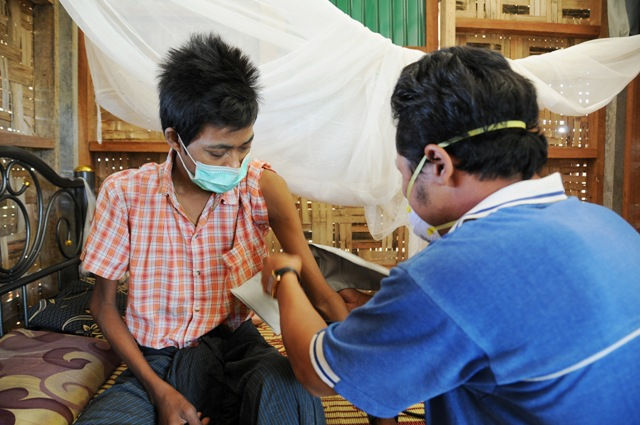Tun Aung Kyaw, a MDR-TB patient, has his blood pressure checked while being treated at the Wangpha TB clinic across the border in Thailand