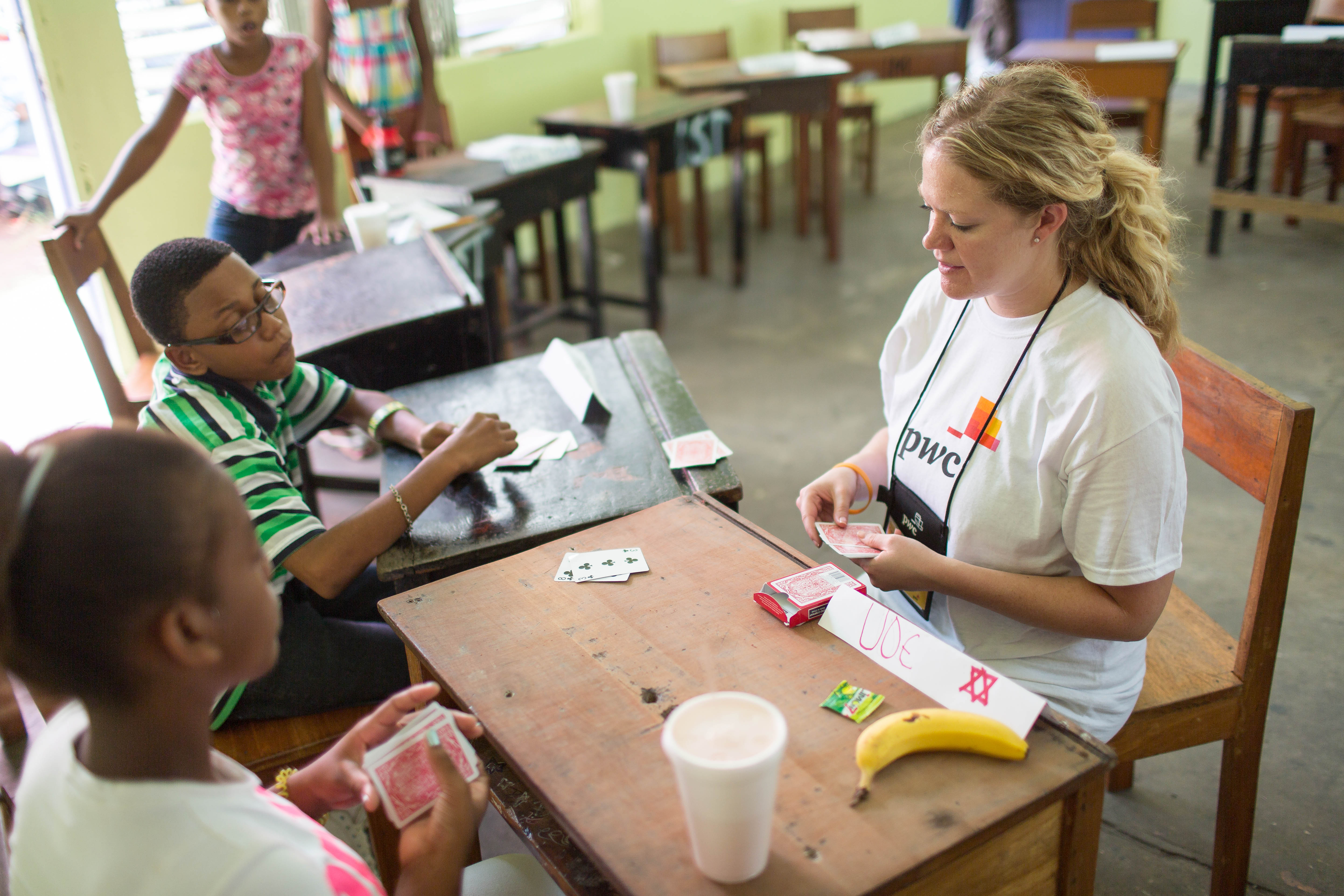 As part of its corporate social responsibility programs, PricewaterhouseCoopers (PwC), a consulting firm, sends partners, staff and interns to teach financial literacy in Belize. Project Belize is part of a program that integrates financial literacy and e