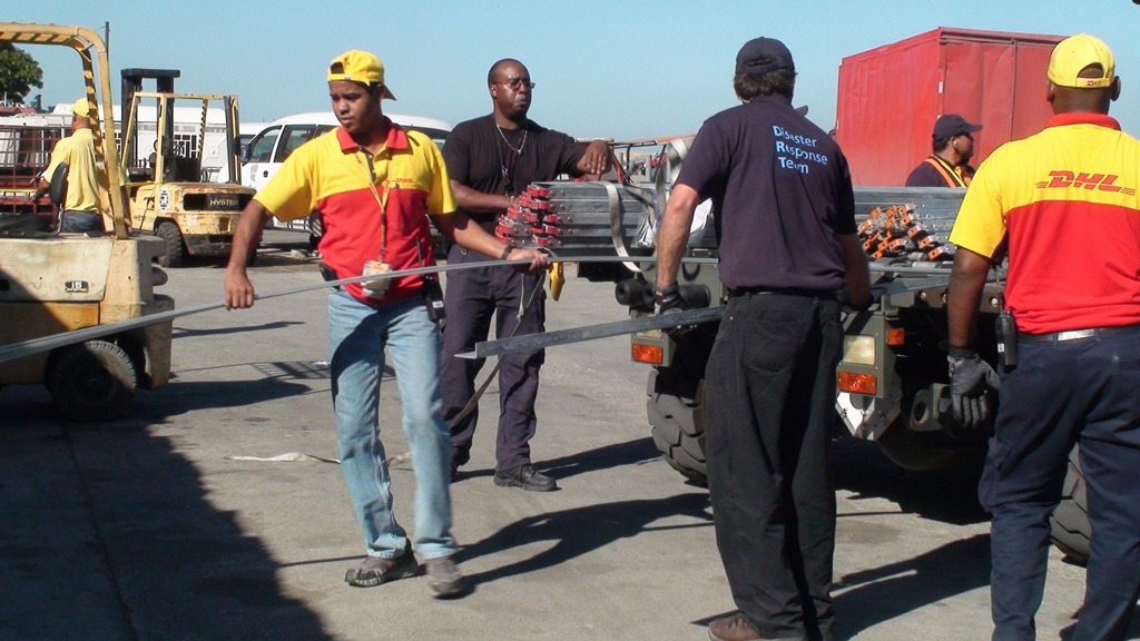 A Disaster Response Team, made up of 10 volunteers from from the courier company DHL, arrives at Toussaint L'ouverture International Airport in Port-au-Prince within 48 hours of the 2010 earthquake in Haiti to help organize incoming aid cargo. DHL says