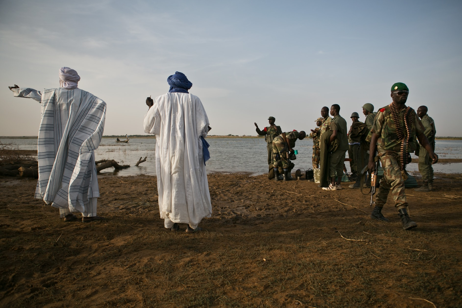 A Malian man points to Kadji, a town surrounding Gao where it is thought that members of MUJAO have been in hiding, in Kadji, Mali, 1 March 2013.