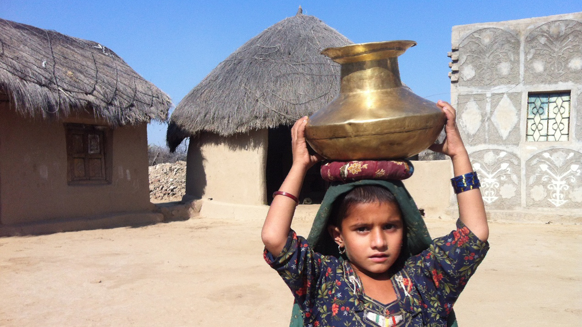 Without water services, children in Pakistan's desert region of Tharparker often need to fetch water instead of attending school