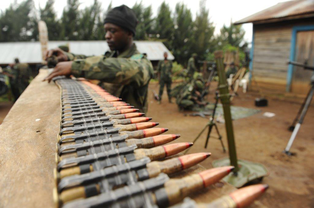 A member of the FARDC's 601 regiment, also known as the Chinois commandos, in the North Kivu province village of Tongo cleans ammunition as part of preparations for operations against the FDLR armed group