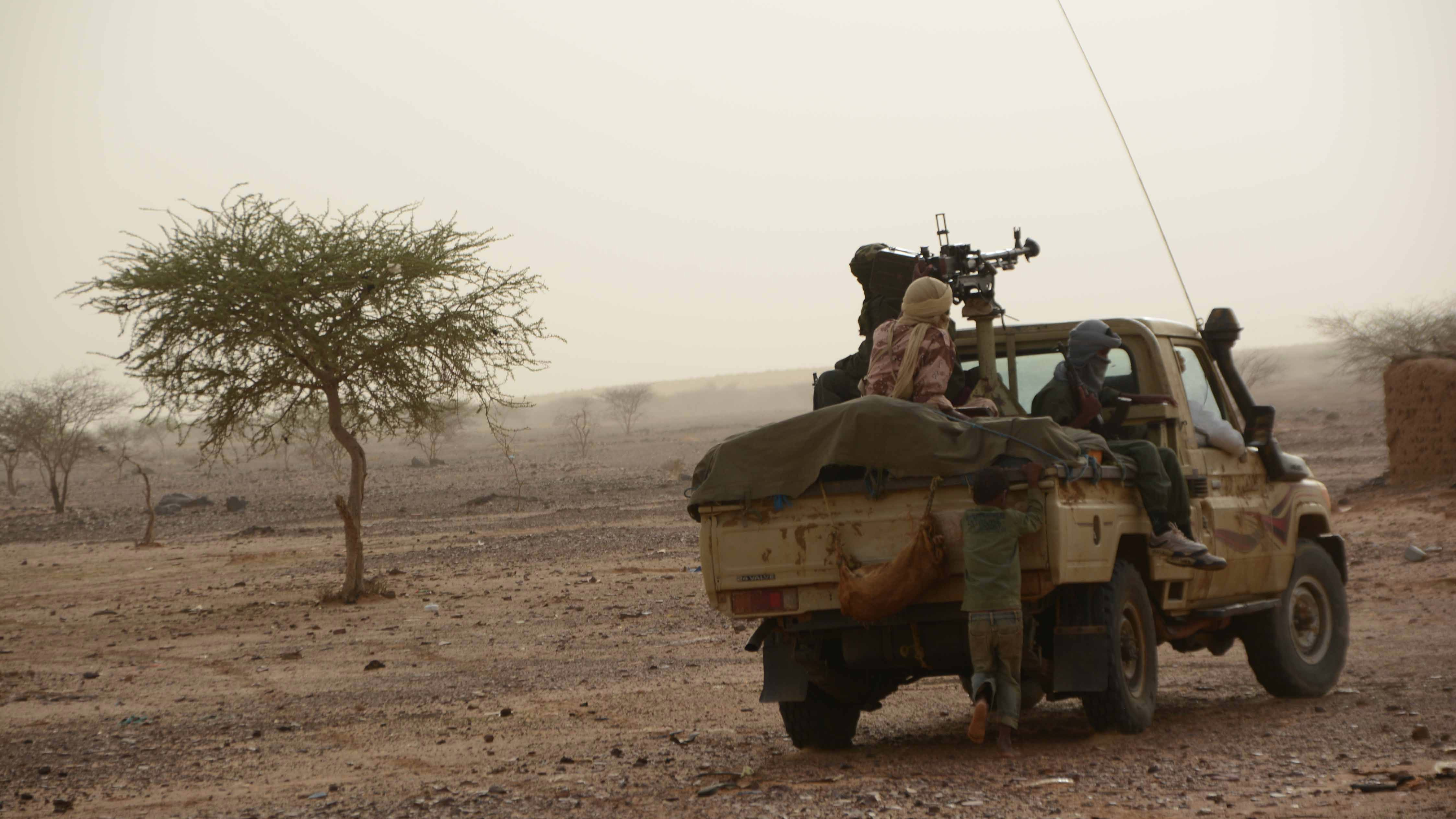 MNLA fighters patrolling in Djebok area, 50 km east of Mali's northern region of Gao which they seized following fighting with government forces in May 2014