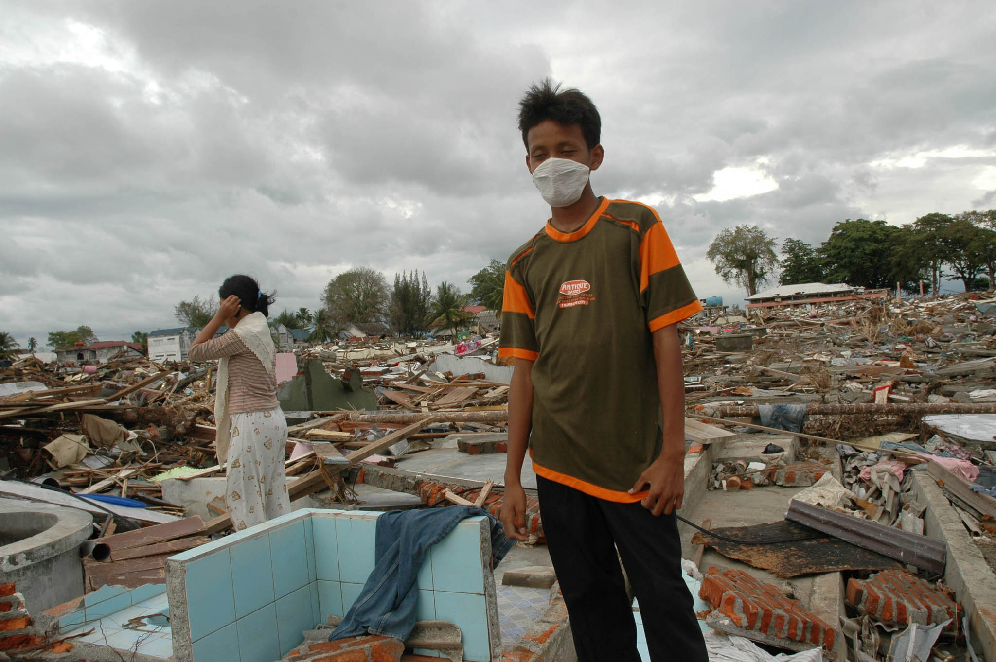 Survivors surveying the ruins of their former homes after the tsunami hit in Meulaboh, West Aceh (File photo 2004)
