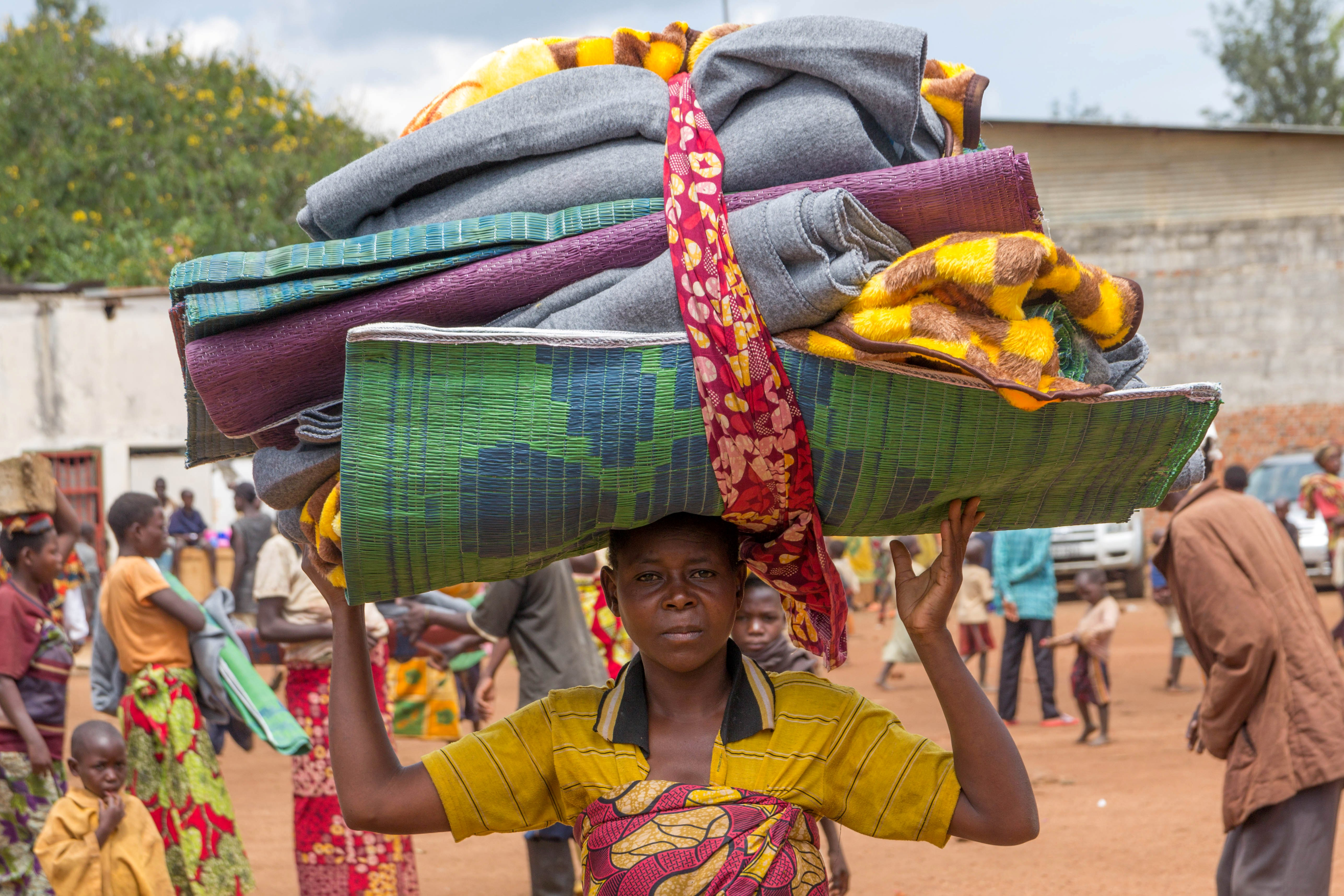 A Burundian mother flees into Rwanda to escape violence back home