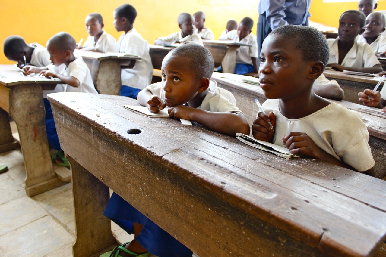 Students learn inside a school built by the local community with support from the IRC's Tuungane program, with funding from USAID. In the absence of state support, communities in North Kivu and remote areas of eastern Congo are taking it upon themselves