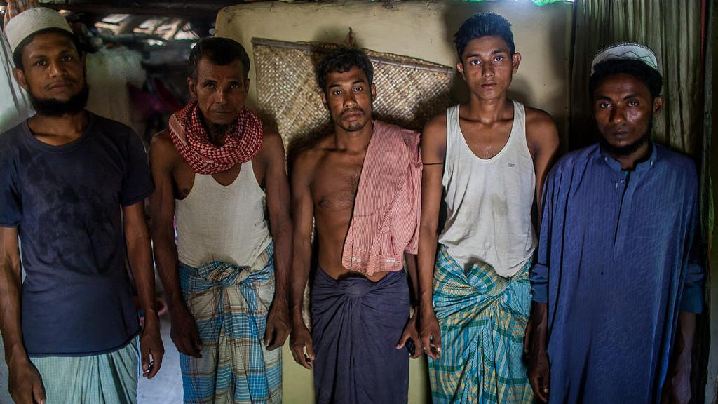 A day or two before departing on a smuggler's boat, a group of Rohingya gather at a safe house.