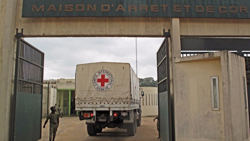 An International Red Cross and Red Crescent Society truck enters the Holding and Corrections Prison of Abidjan (MACA).