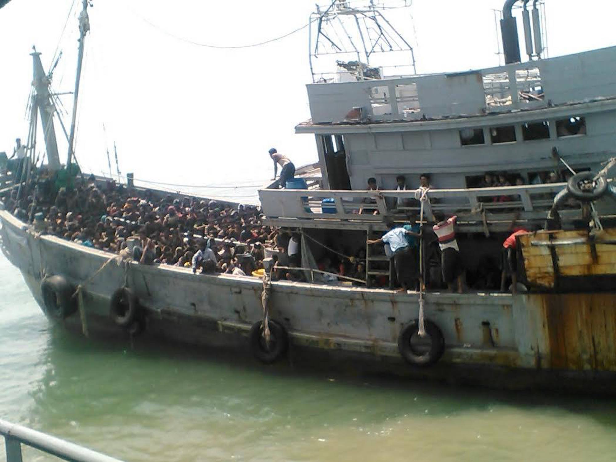 "Myanmar's navy found a boat with 727 ""Bengalis"" – a term it applies to both Rohingya and Bangladesh nationals – and started towing it on May 29, 2015 to a naval base"
