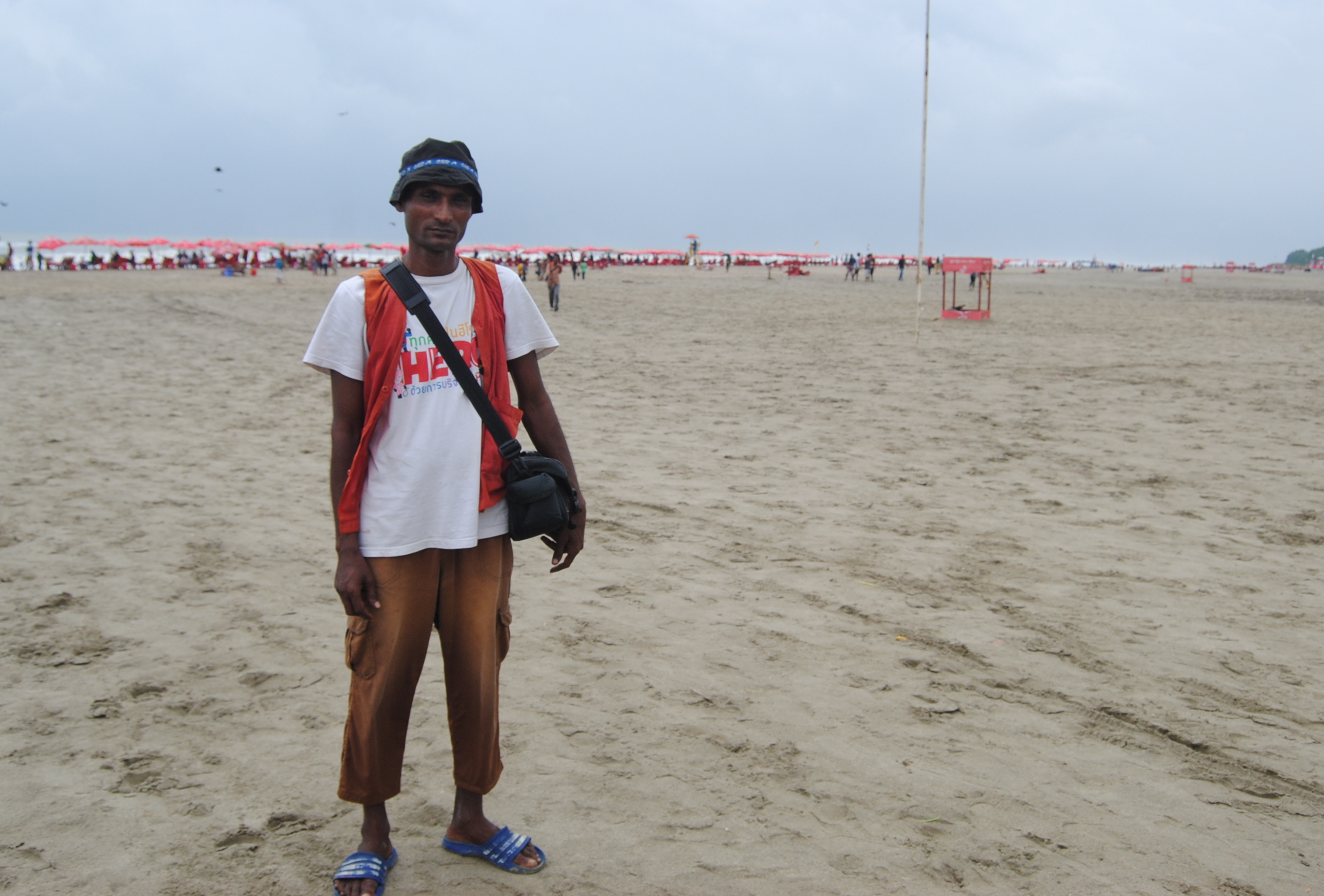 Mohammad Nurannabi, a victim of human trafficking, is back to work as a beach photographer in Cox's Bazar, Bangladesh