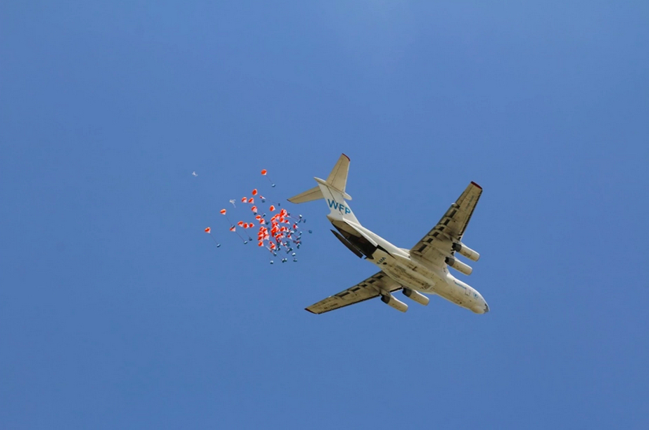 Villagers in Ganyiel, a small village surrounded by swampland in southern Unity State of South Sudan, have become accustomed to seeing planes airdrop bags of cereal and pulses but seeing vegetable oil falling from the sky was something new. This happened