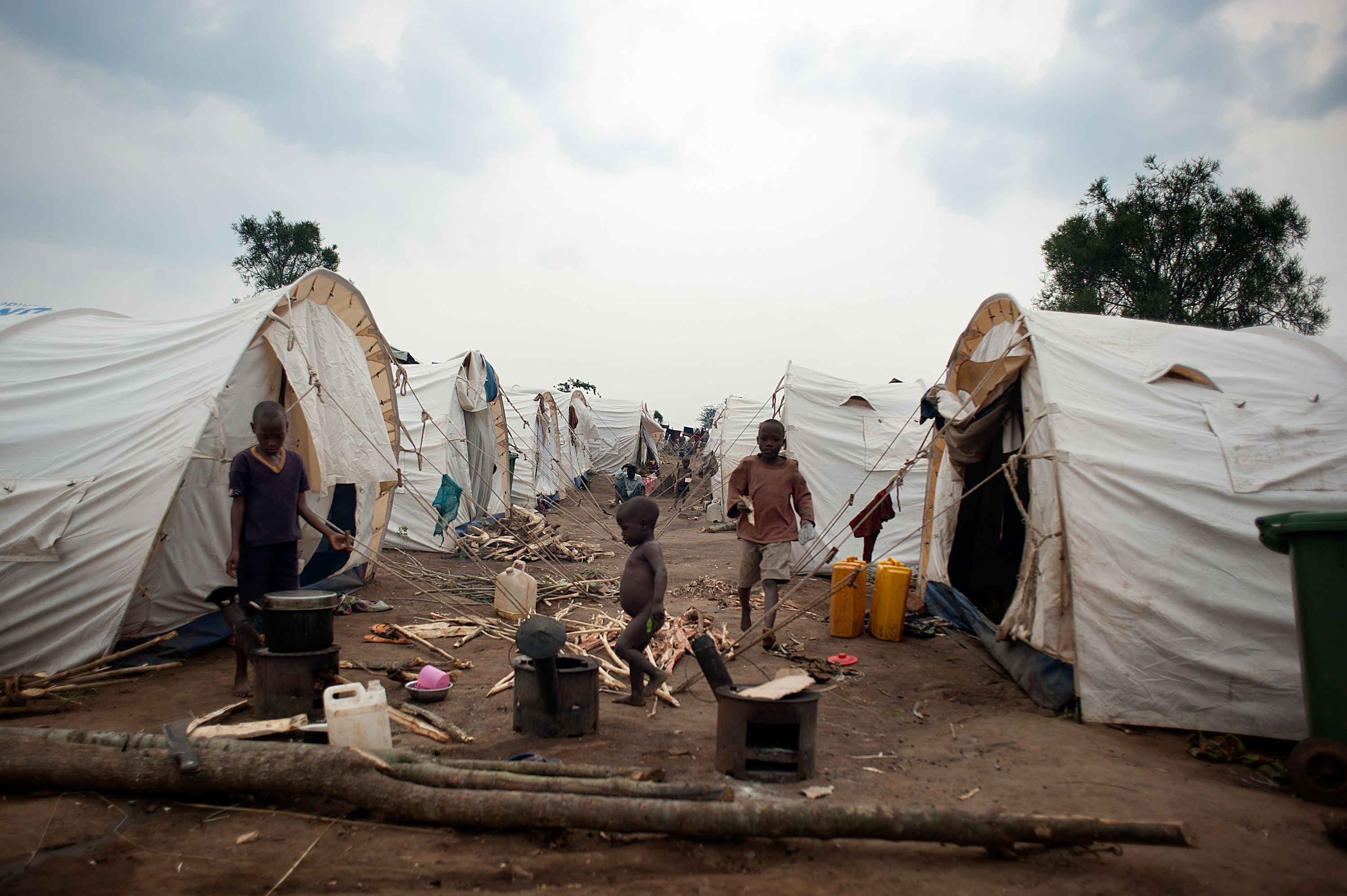 A view between tents within the Mahama refugee camp. Families live extremely close together, and cooking must be done outside.