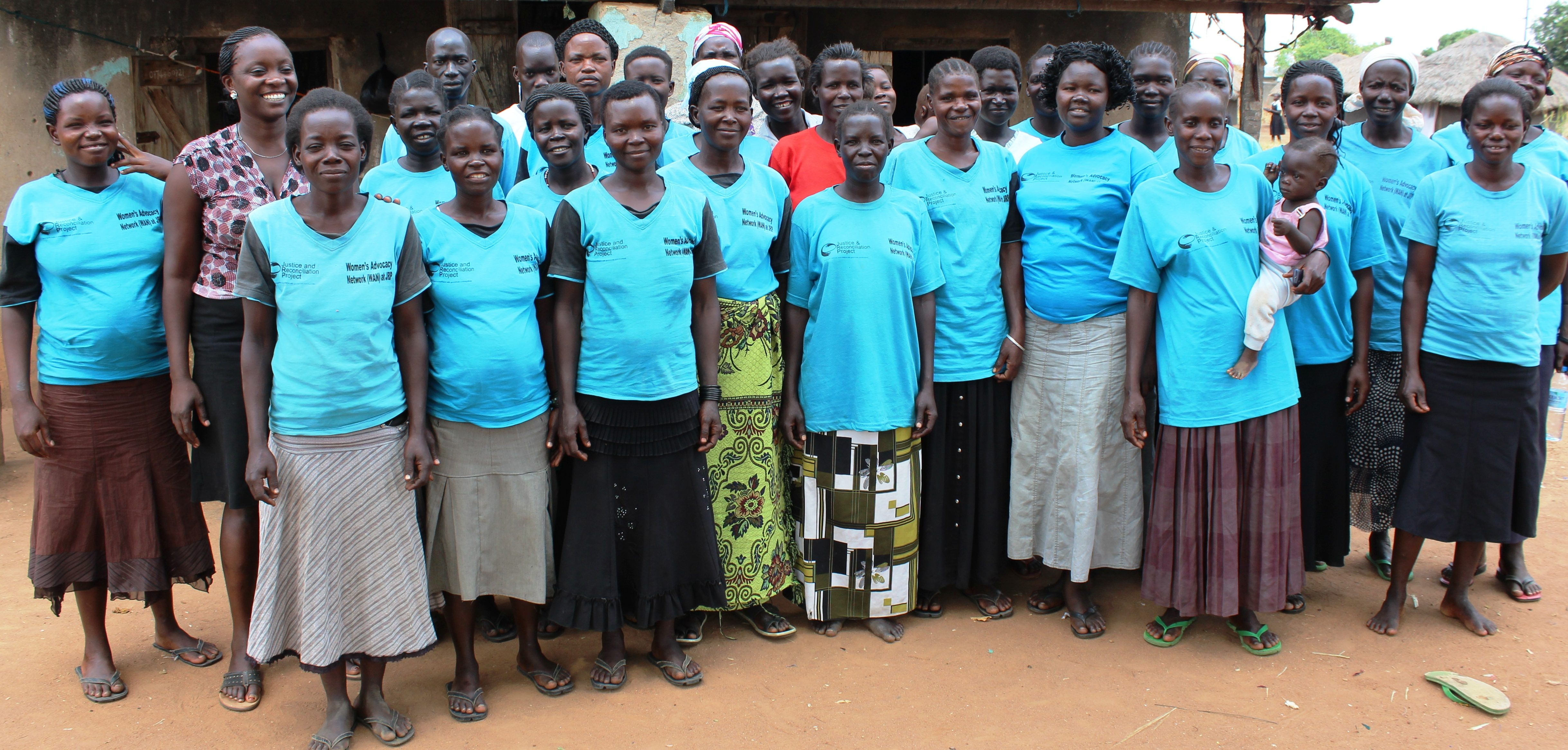 Some of the conflict-affected women including mothers of children born of war pose for a picture in Awach, Gulu district during JRP study.