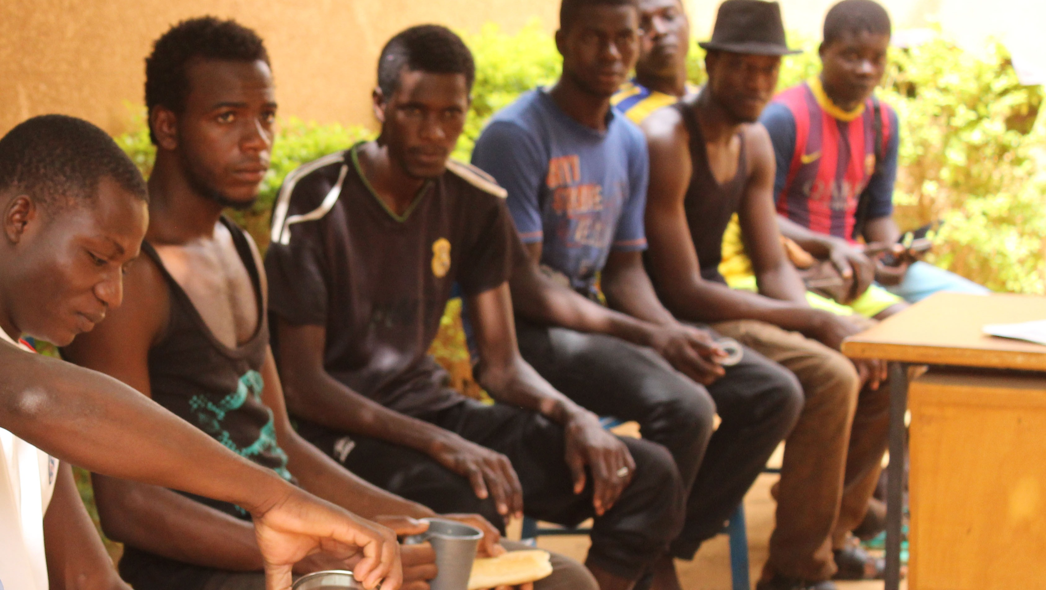 A group of West African would-be migrants, who failed to complete their journey to Europe, await repatriation outside the International Organisation for Migrants' reception centre in Niamey, Niger.