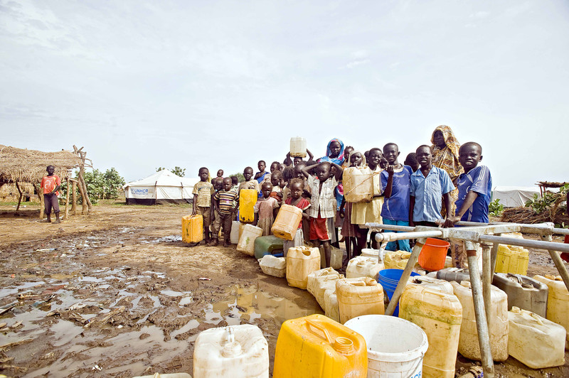Children and women queue at a water point, in Jamam refugee camp, Republic of South Sudan.