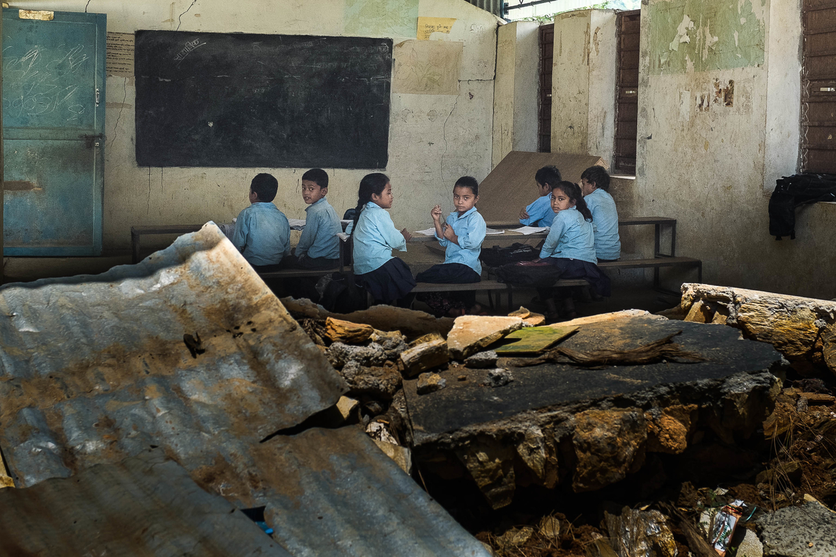 Students attend classes inside school buildings damaged by the earthquake on 10 August 2015 in Sipa Pokhari, Nepal. This school in Sipa Pokhari VDC was badly damaged during the earthquake, but with only one tent provided by NGOs, the rest of the students