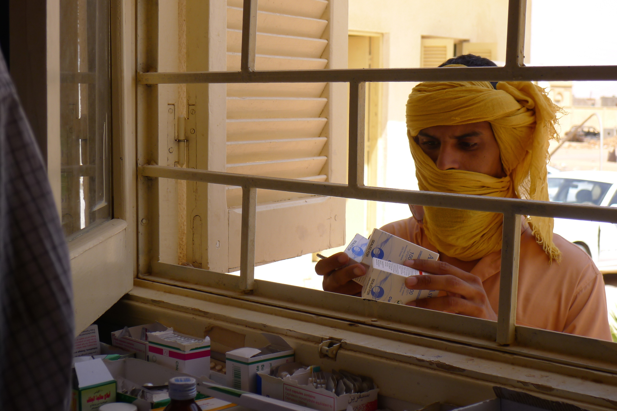 A Libyan man receives medication from the only pharmacy in Ubari, a town in southern Libya