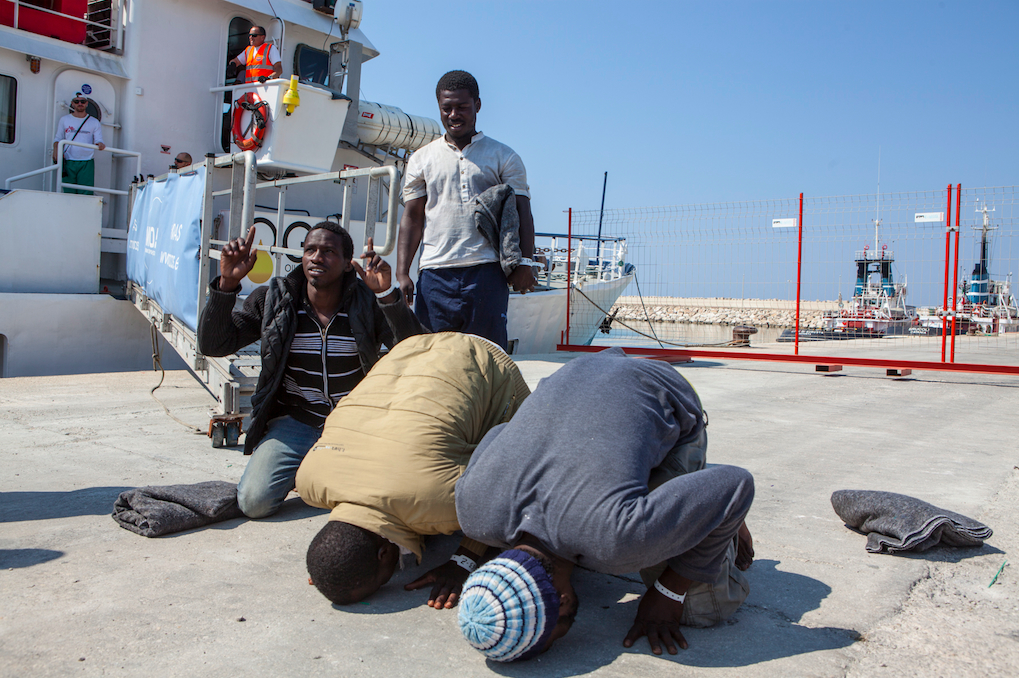 "Mohammed Lamin quit his job, borrowed money from his brother, and left the Gambia for Europe via the ""back way"" - the highly dangerous overland route to Libya through the Sahel, and then on to Europe on a smuggler's boat. Here he is arriving in Italy."