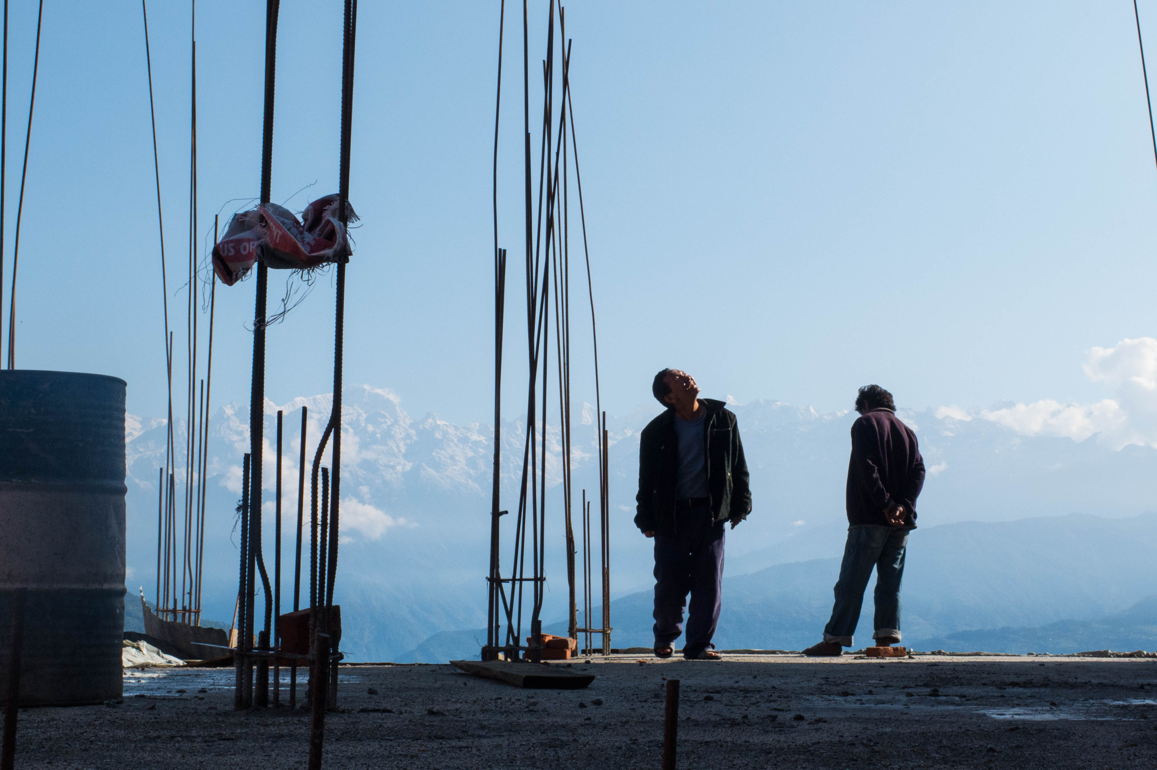 Two men survey construction in October 2015 in Charikot town in Nepal's Dolakha district, which was at the epicentre of the earthquake on 25 April 2015