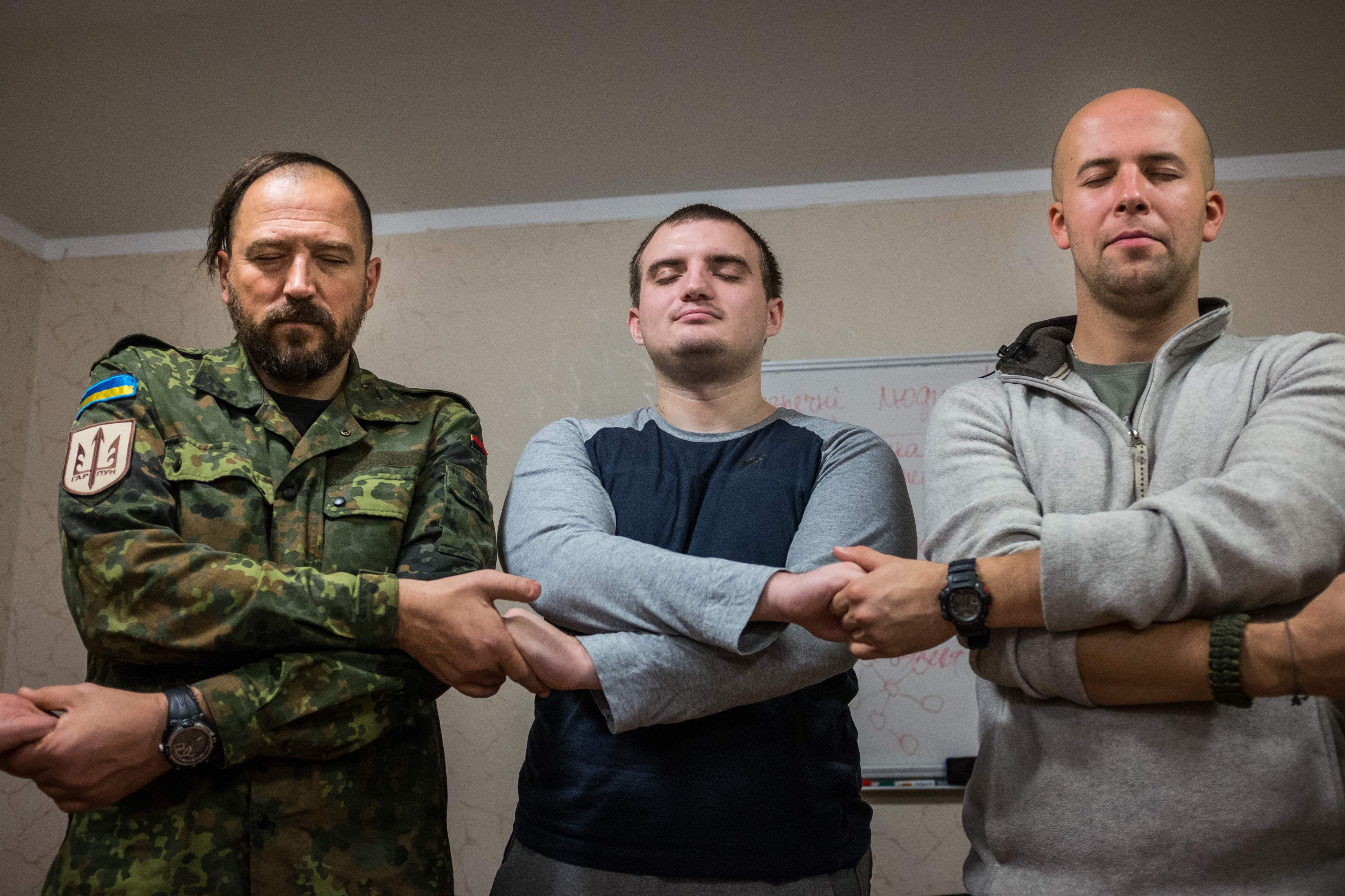 Soldiers hold hands during one of the exercises in a workshop organised by Wounded Warrior Ukraine. A part of the problem lies with the fact that mental illness is still a stigma in the Ukraine and soldiers have a hard time reaching out for help.
