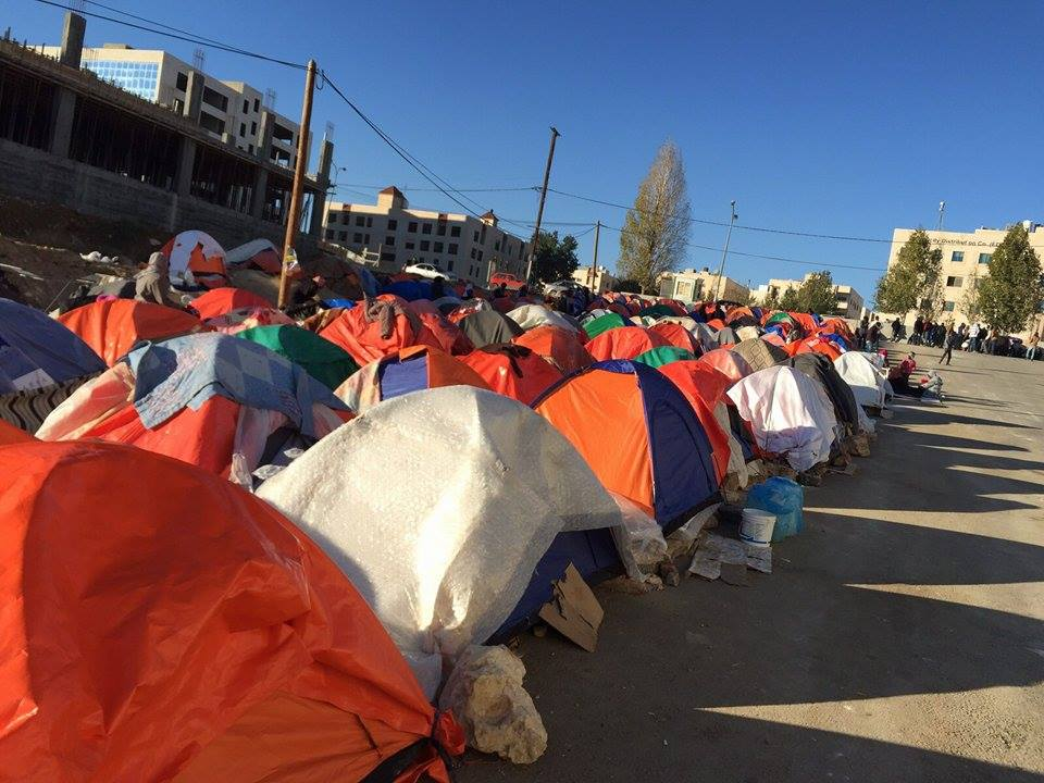 Sudanese refugees and asylum seekers camped out outside the UNHCR offices in Amman in December 2015.