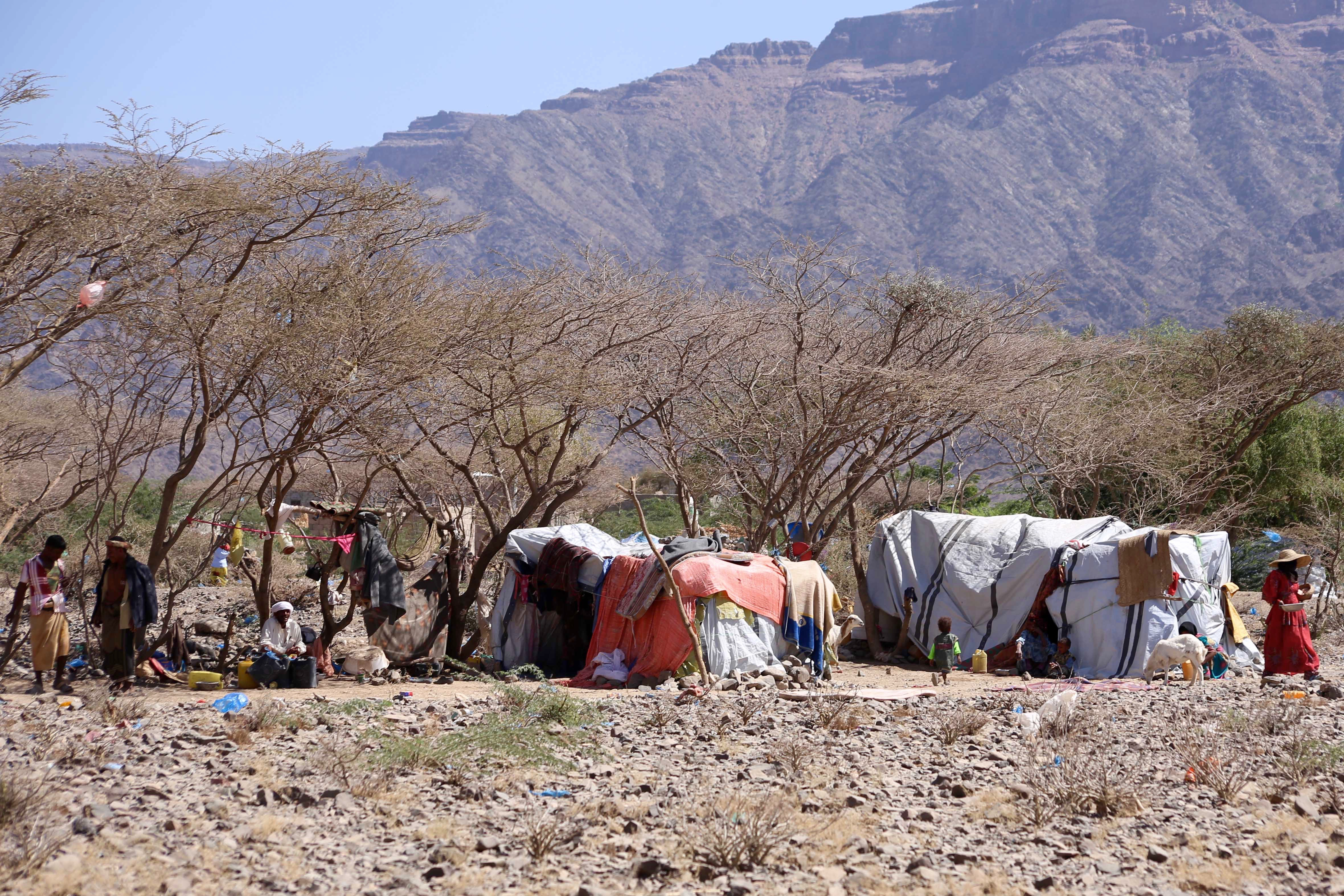 IDP shelters with mountains behind in Yemen