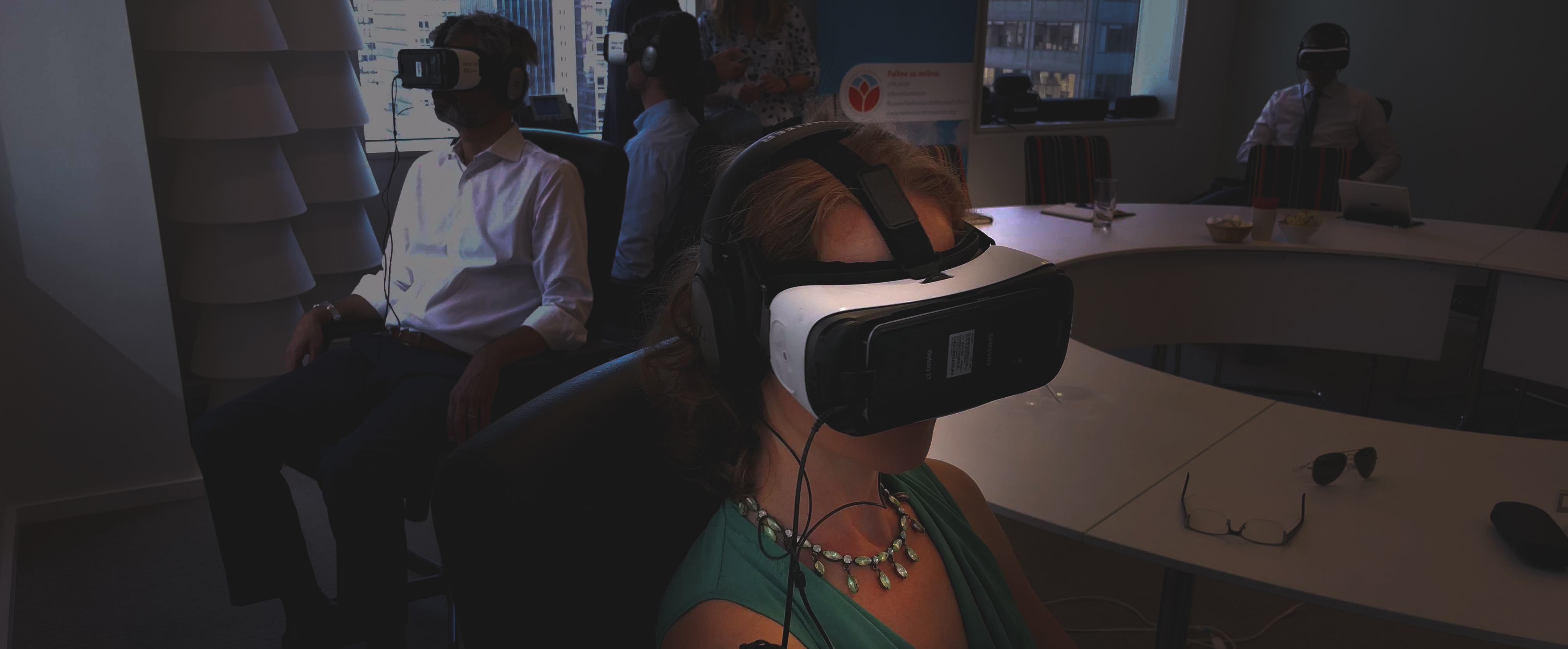 People watch a VR film using a headset