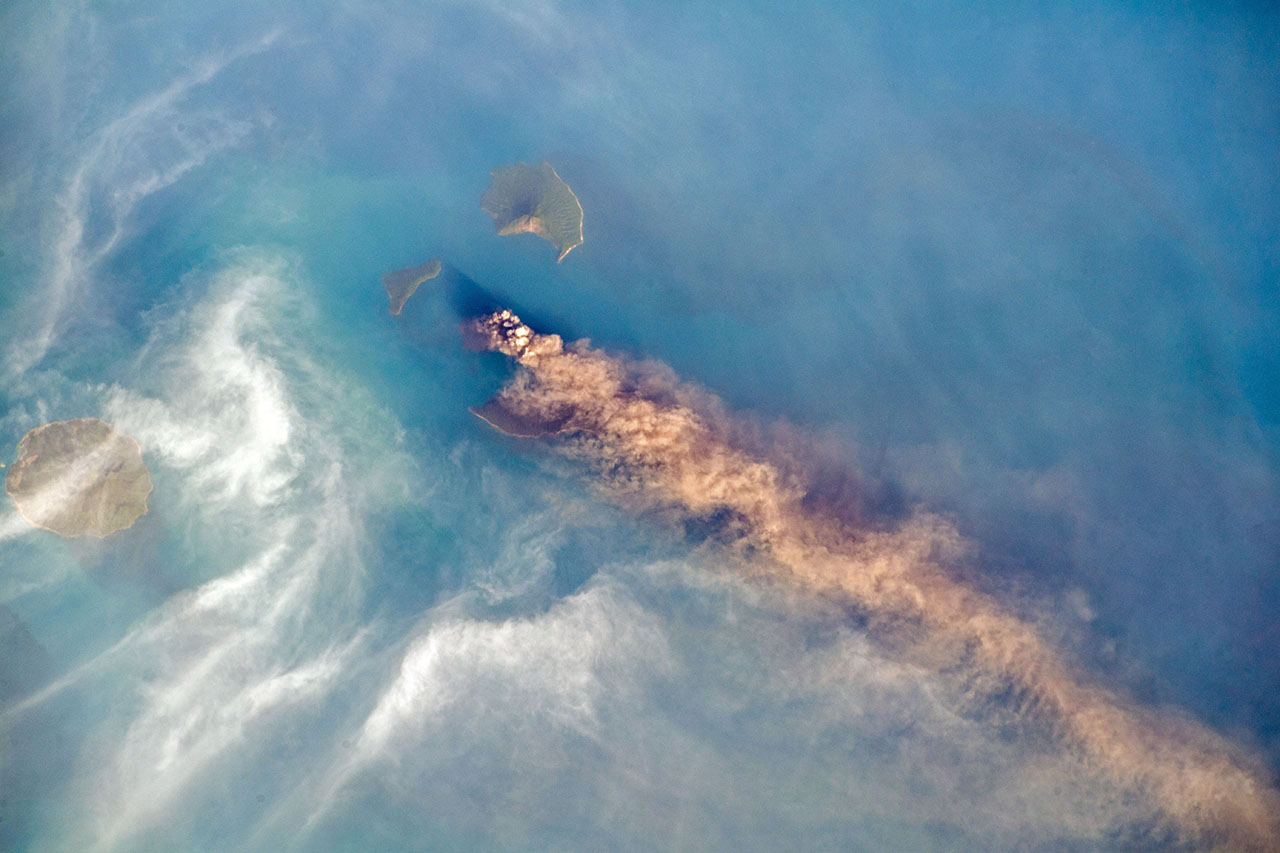 Krakatau seen from above as plumes billow in the wind