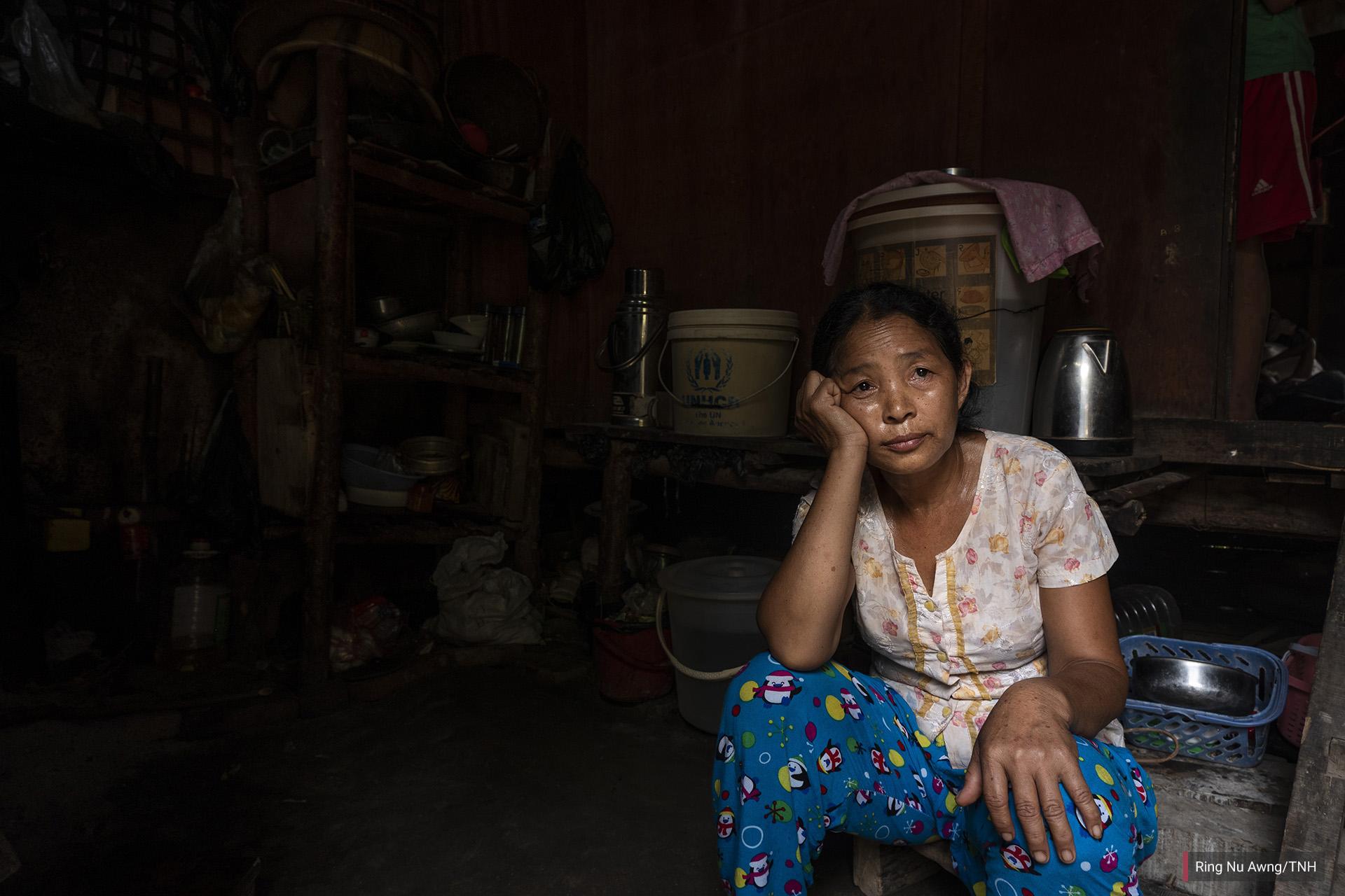 Lashi Lu, 48, sits in her shelter in Je Yang