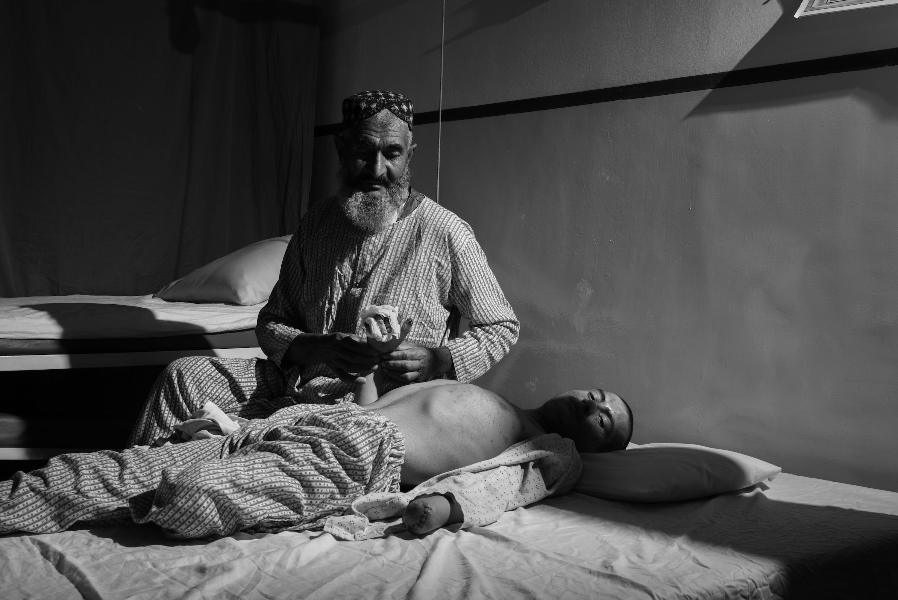 A father at his son's hospital bare hospital bed