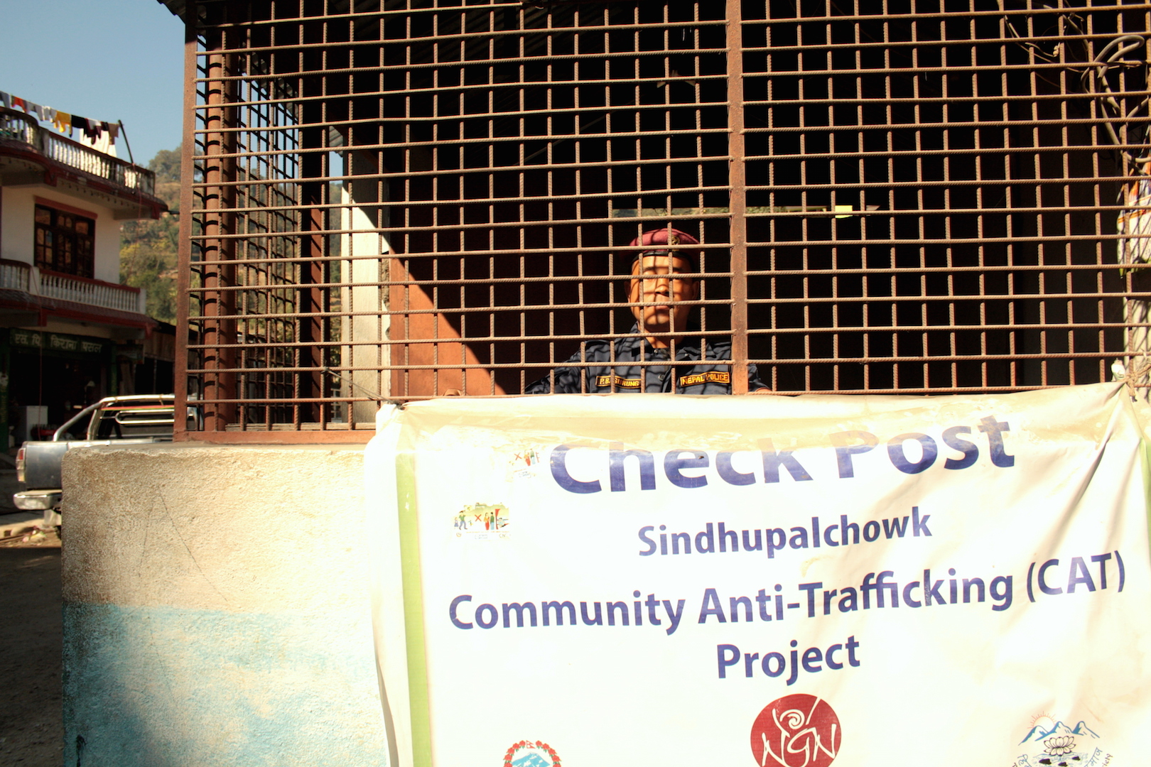A Nepal Police officer looks out from an anti-trafficking check post in Sundhupalchok