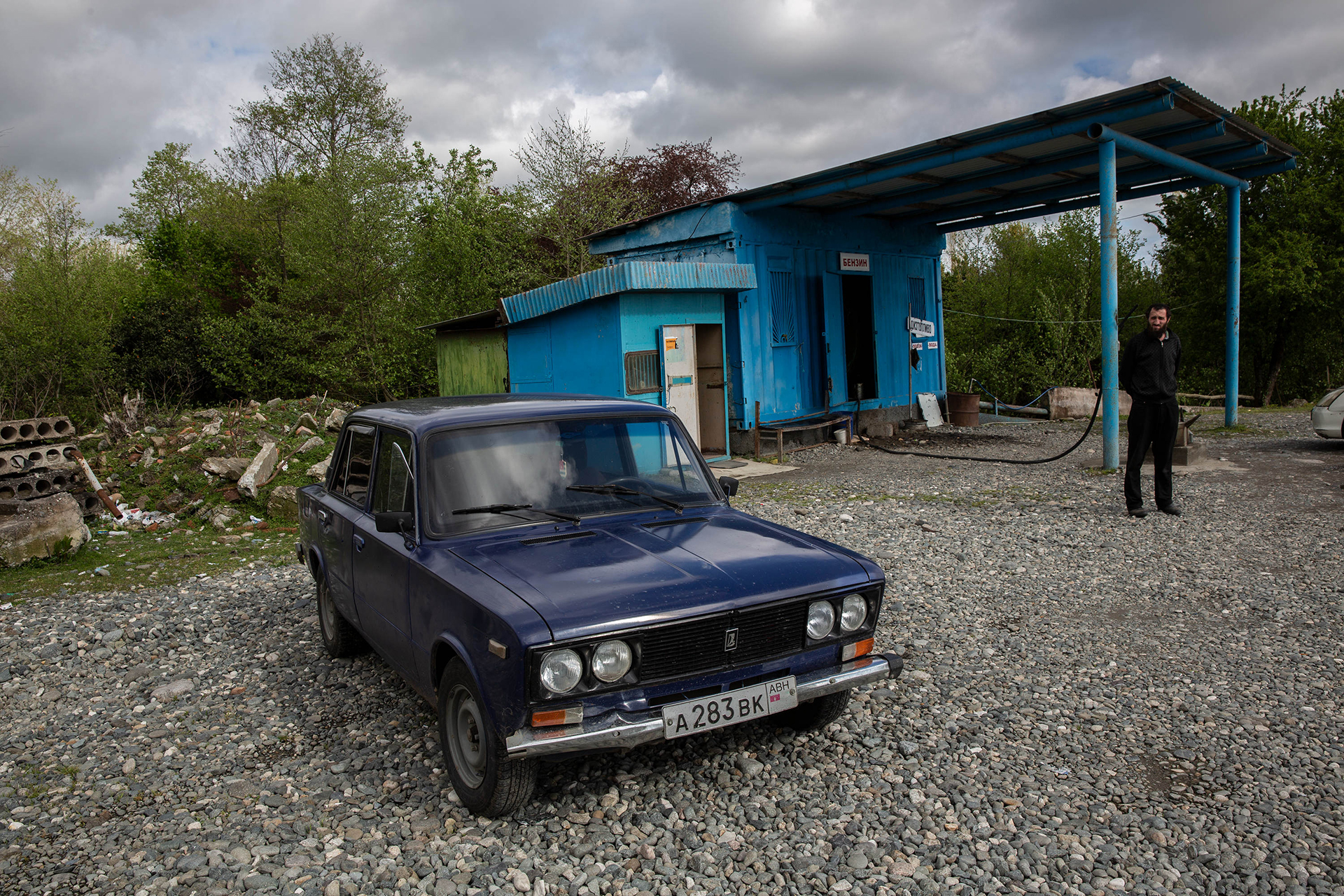 An old Soviet car sits in front of a refueling station near Labra, Abkhazia on 20 April 2019.