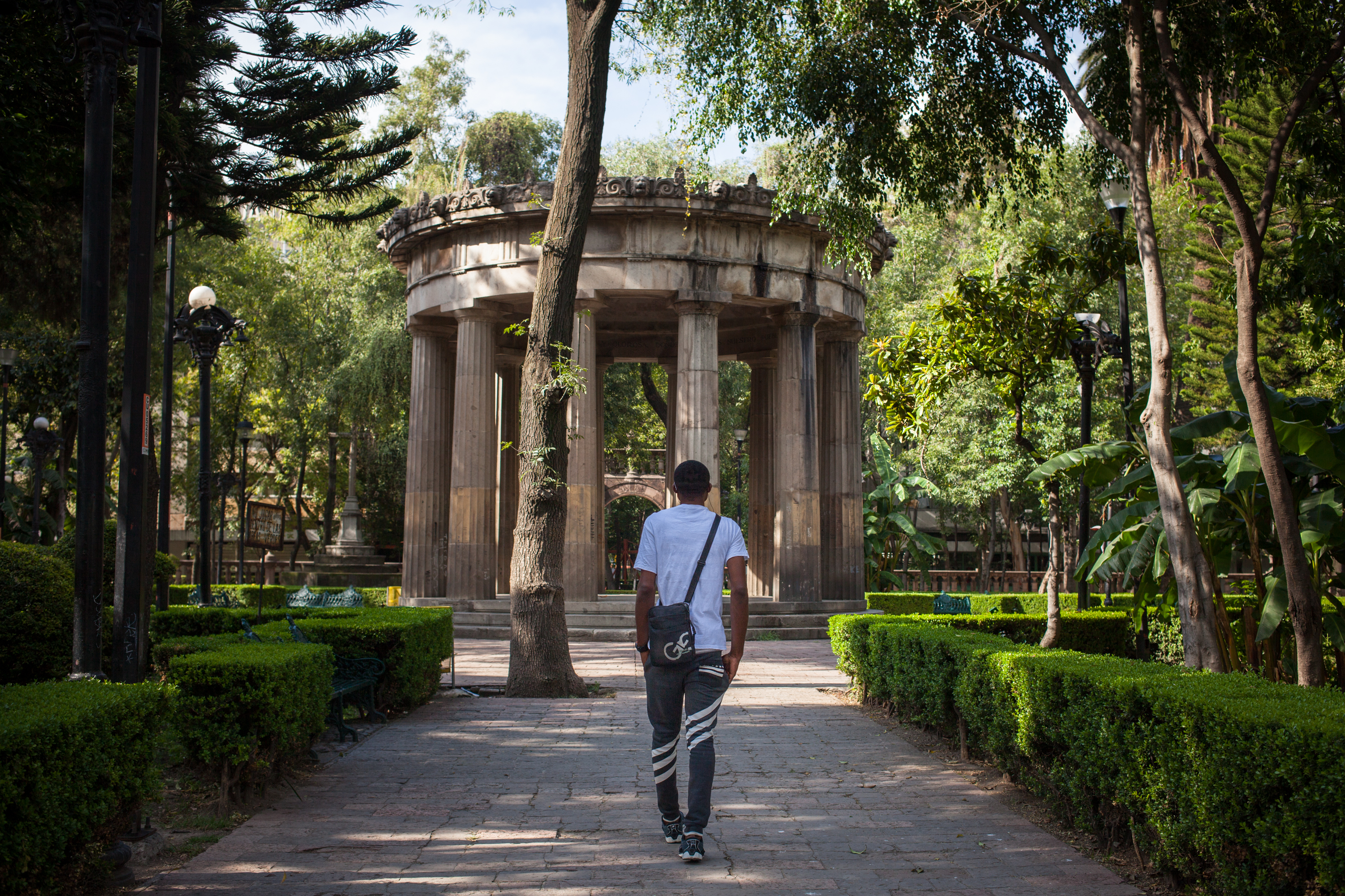 Victor walks through a park in Mexico City