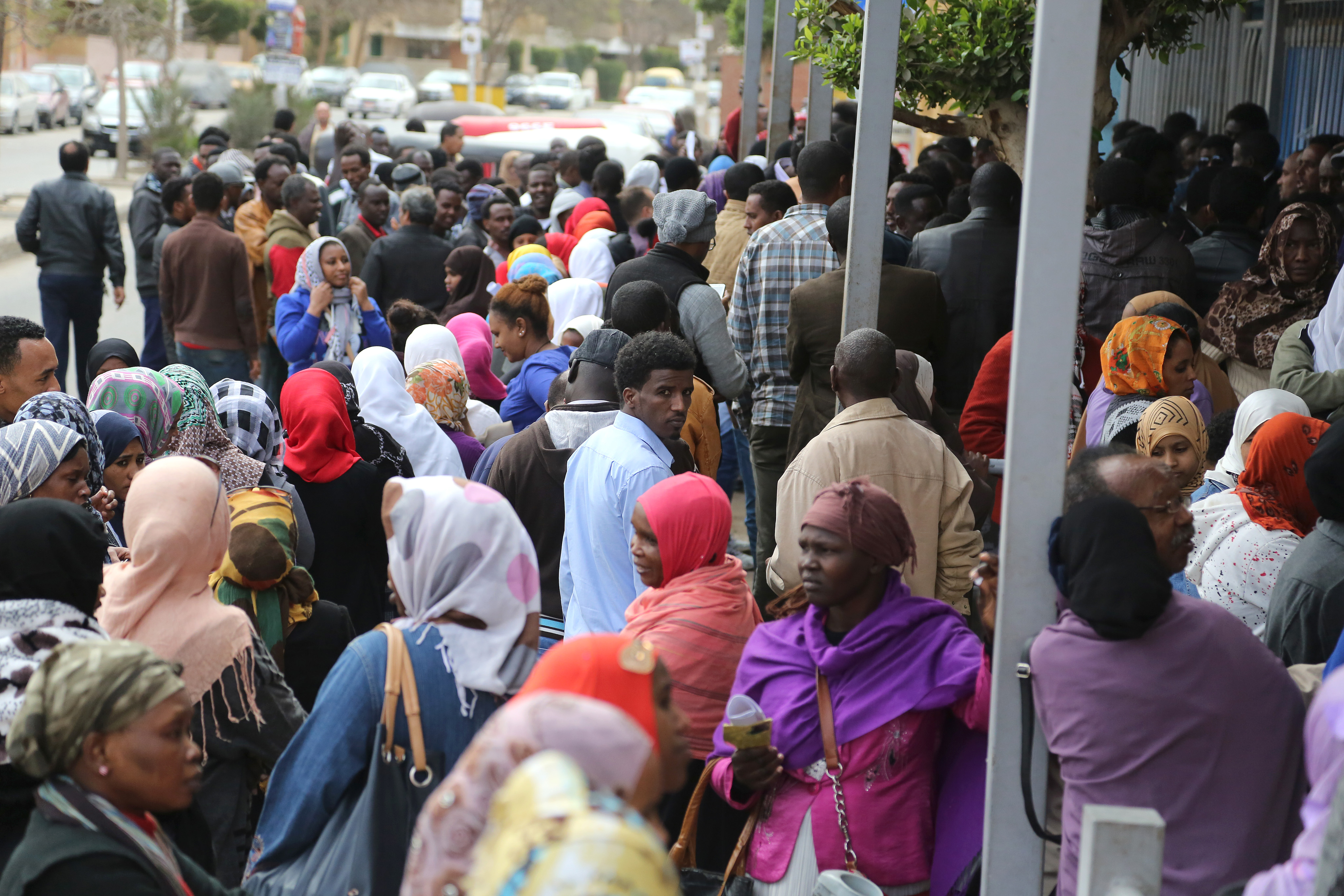 Refugees queue to be registered as they wait outside UNHCR office in 6th of October city at the outskirts of Cairo, Egypt