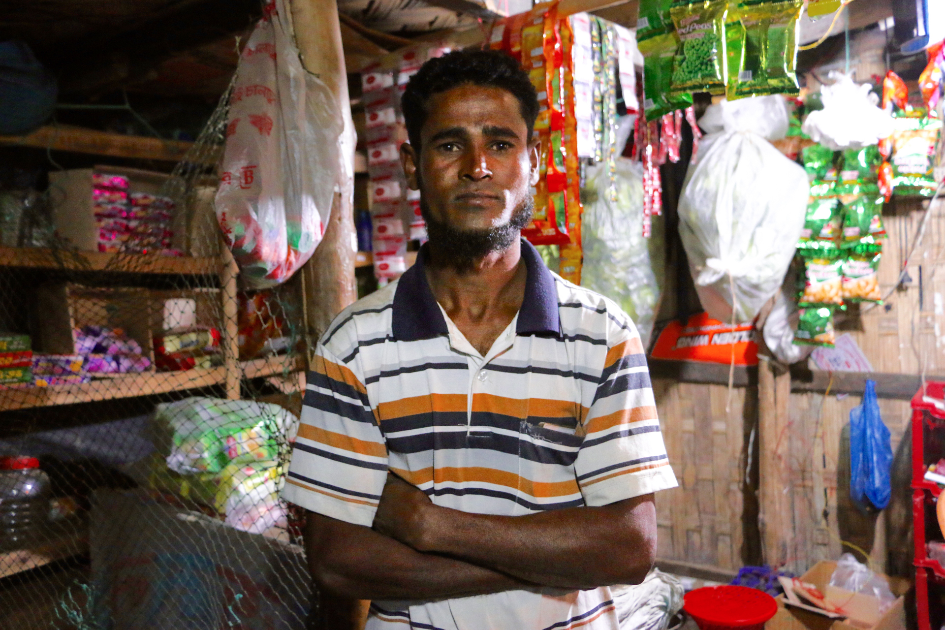 "Hashim Ullah, 30, lost all his important papers when he fled Myanmar. His only ID is a refugee card issued in Bangladesh. It grants him little in the way of rights, but allows him to eat: ""Without this card, I can't get food rations,"" he says."