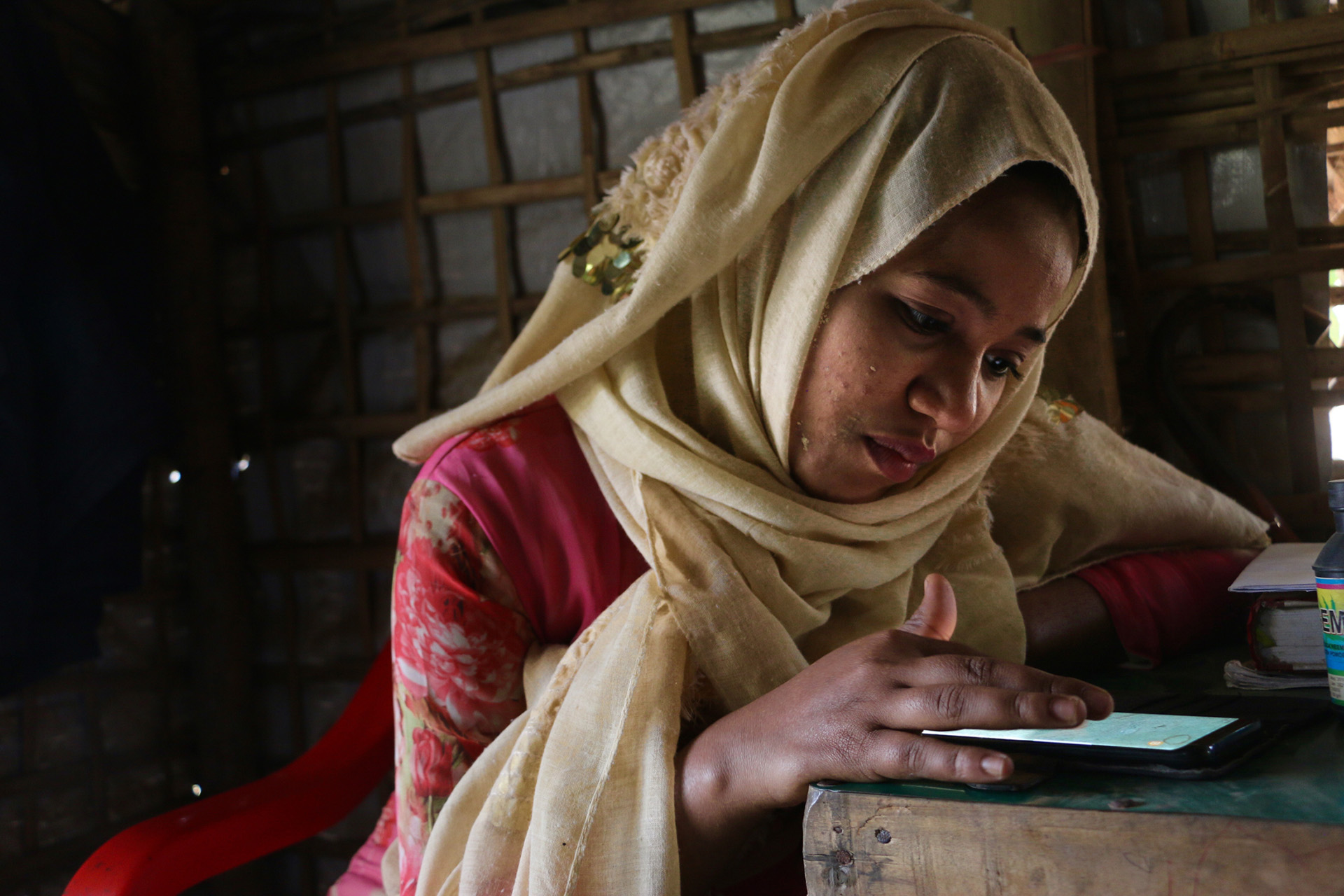 Image of Omal Khair on her phone