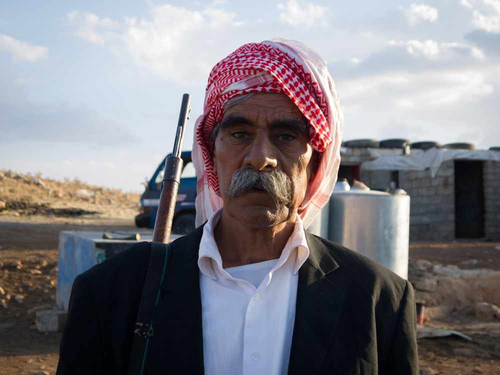 A Yadizi man on top of Mount Sinjar with a rifle slung on his shoulder