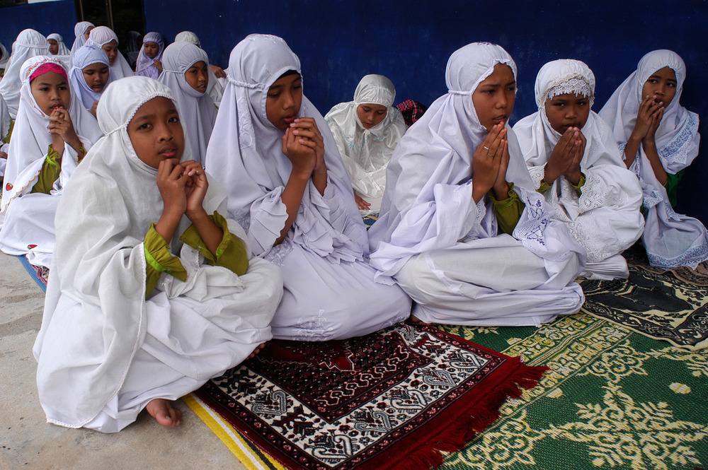 Female students from Ban Paku Village pray