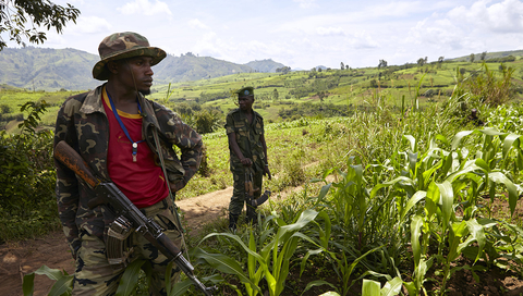 Two Nyatura Domi rebel fighters stand on guard duty in a Nyatura stronghold position outside the town of Nyanzale, North Kivu.
