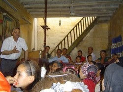 [Egypt] Priest in Minya talks to women about the dangers of FGM. [Date picture taken: 2005/07/03]