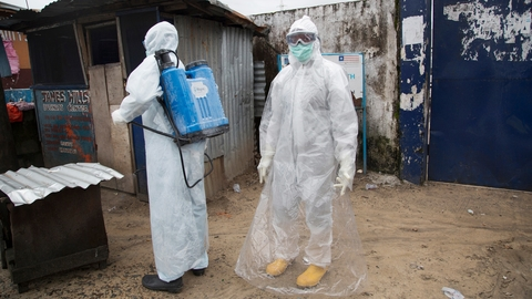 A team cleans an area where a suspected Ebola patient sat outside waiting hours for treatment - potentially infecting others in the process. (Sep 2014)