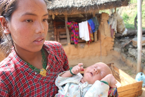 Nirmala Tamang and her 3-week old son, at Ghumarchowk village, 20 km from Kathmandu. Her family lost their home and livestock in the earthquake that struck Nepal 25 April